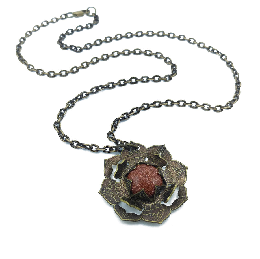 etched flower mandala necklace with goldstone