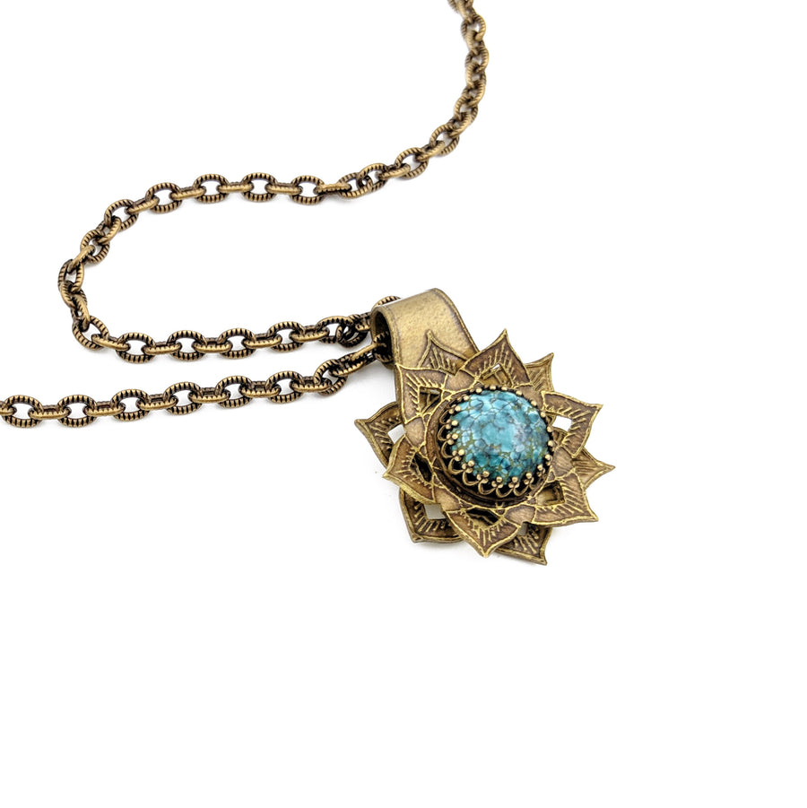 Spinning flower mandala necklace with chrysocolla