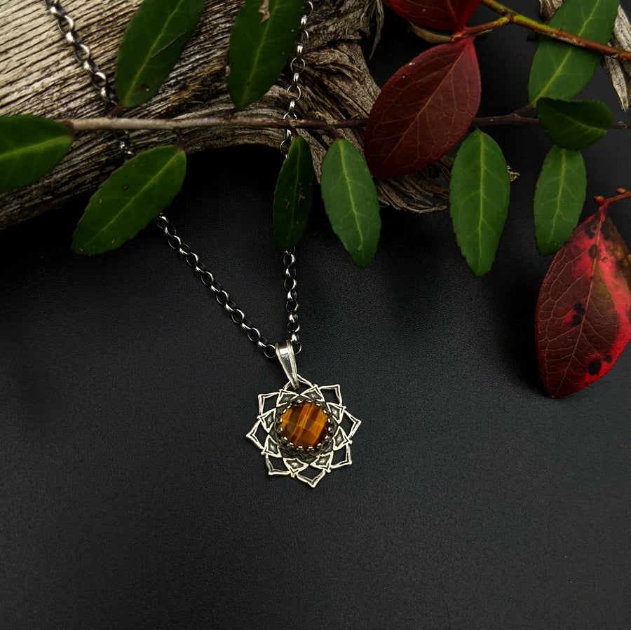 simple sterling silver flower mandala necklace with tiger eye