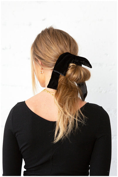 Holiday How-To: A Velvet Bow Half Ponytail - OUAI