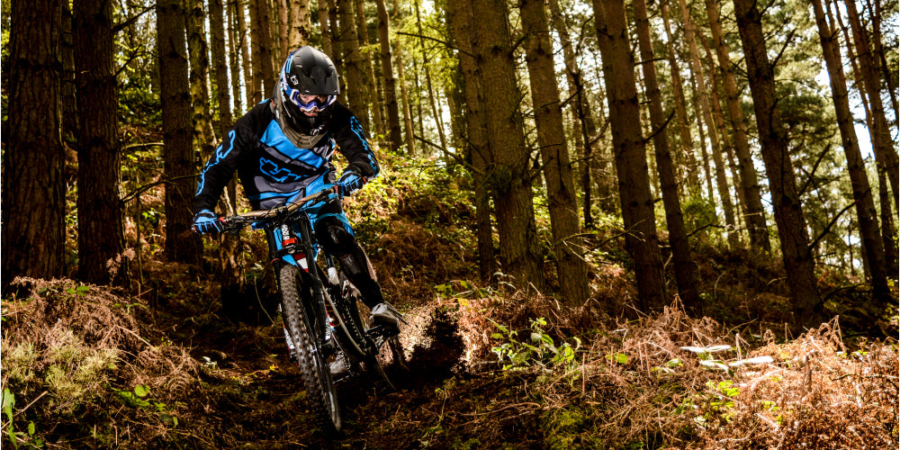 Danny Wilson Shredding his Downhill Bike in the woods of UK in T3 Helmet, Rays Jersey, Hex Gloves, Tek2 shorts, F2-Storm Shin Guards