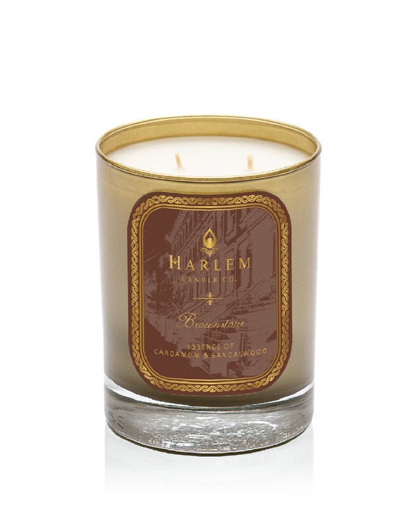 Brownstone luxury candle scented with cardamom and sandalwood.This is a photo of the Brownstone Luxury Candle. This candle is scented with lemon, bergamot, cardamom, saffron, freesia, blonde woods, amber, patchouli and sandalwood.