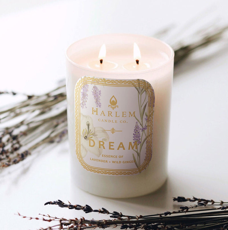 This photo is of our Dream Luxury Candle. Scented with jasmine, geranium and iris petals.
