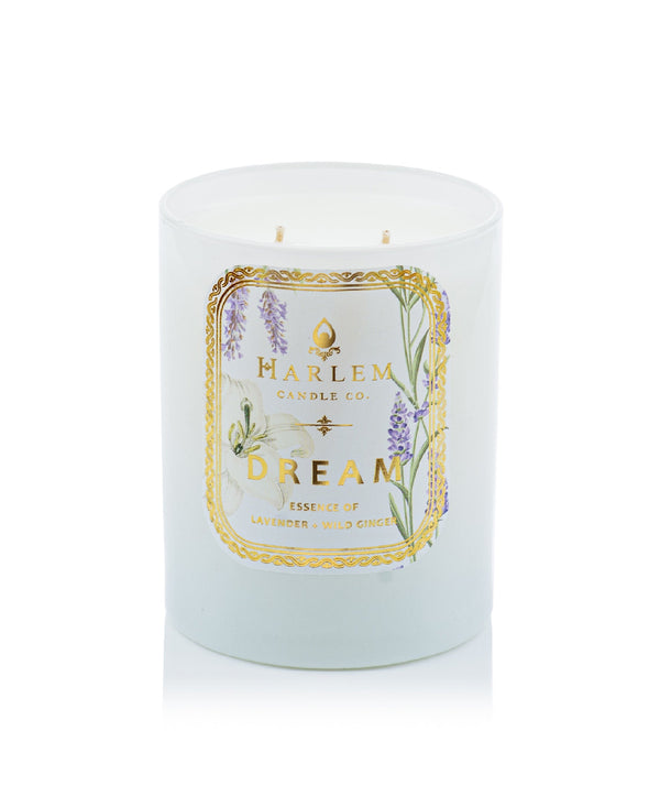 This is a photo of the Dream Luxury Candle. This candle is scented with lavender, pimento berry, bergamot, jasmine, geranium, iris petals, wild ginger, carnation, crushed pine needles, amber, patchouli, cardamom, sandalwood and blonde musk.