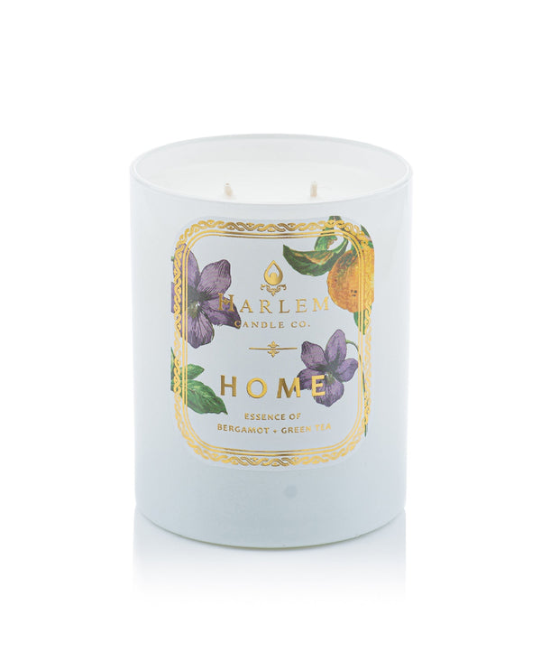 This is a photo of the Home Luxury Candle. This candle is scented with bergamot, mandarin orange, neroli, violet, green tea leaves, lilac, jasmine, sandalwood, golden amber, musk and tonka bean.