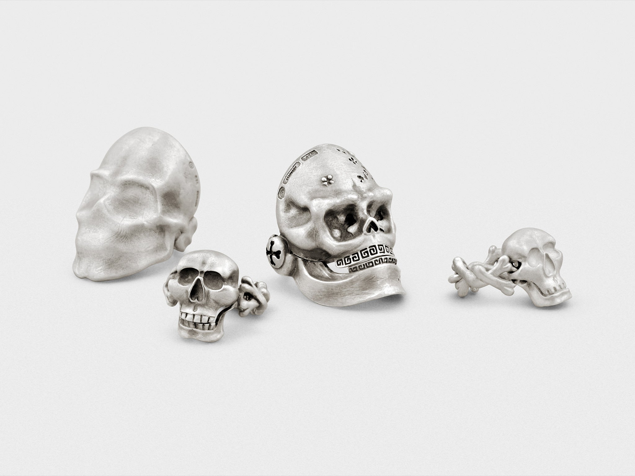 Handcrafted sterling silver skull rings by Snake Bones