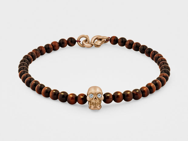 Skull Bracelet in 18K Gold with Diamond Eyes, Red Tiger Eye and Snake Clasp