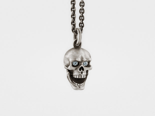 Skull Pendant with Hinged Jaw and Diamond Eyes in Sterling Silver