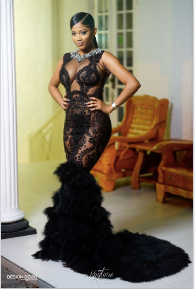 MANDA ONYX  beaded gown with extended feather train