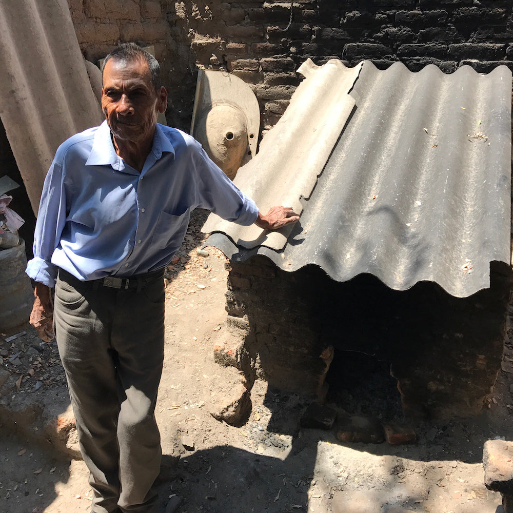 Serapio Medrano with his brick low fire kiln.