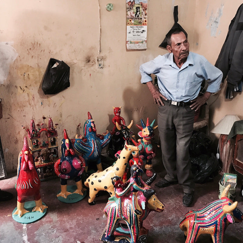 Mexican Folk Artist Serapio Medrano with his ceramic sculptures at his home in Tonala