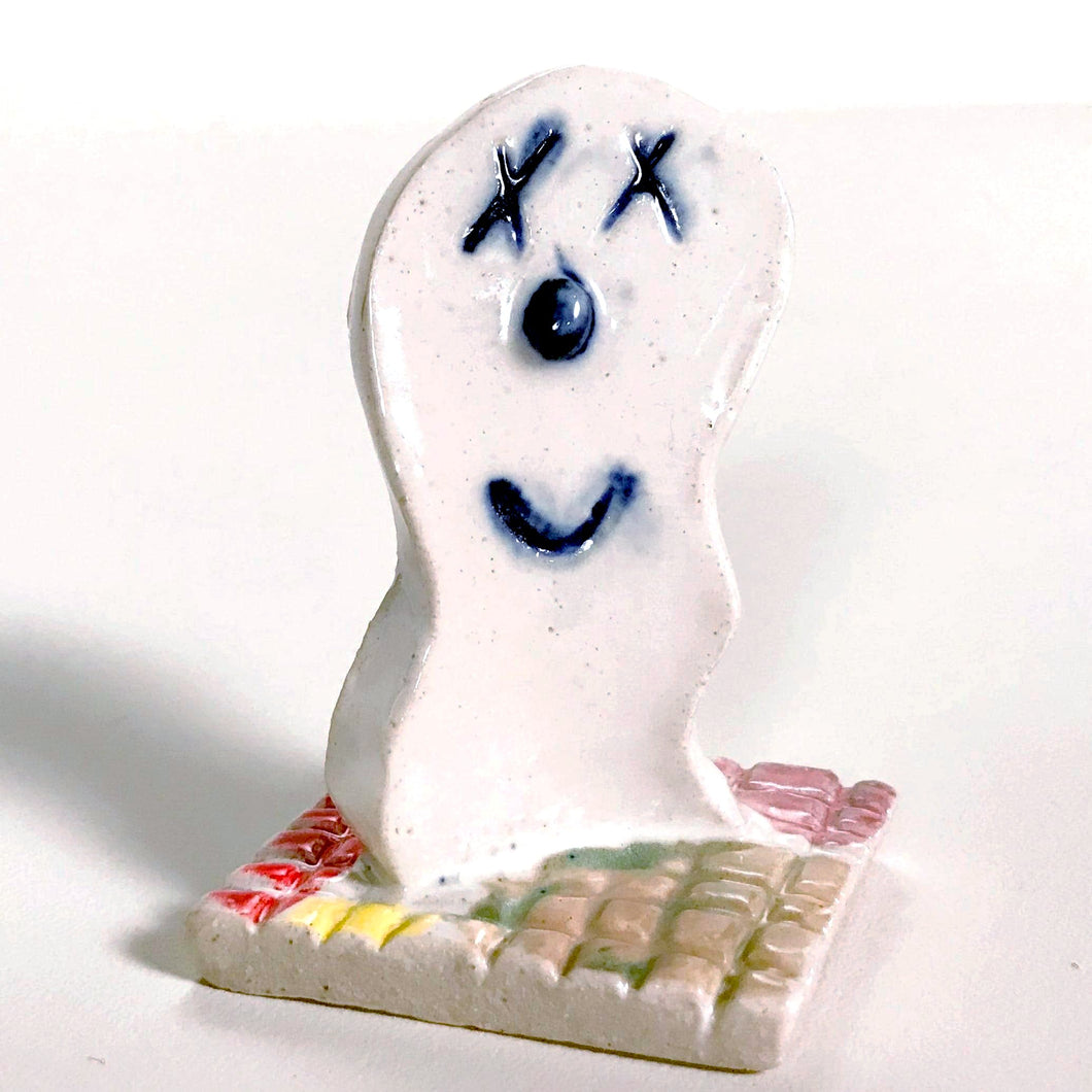 happy ghost sculpture