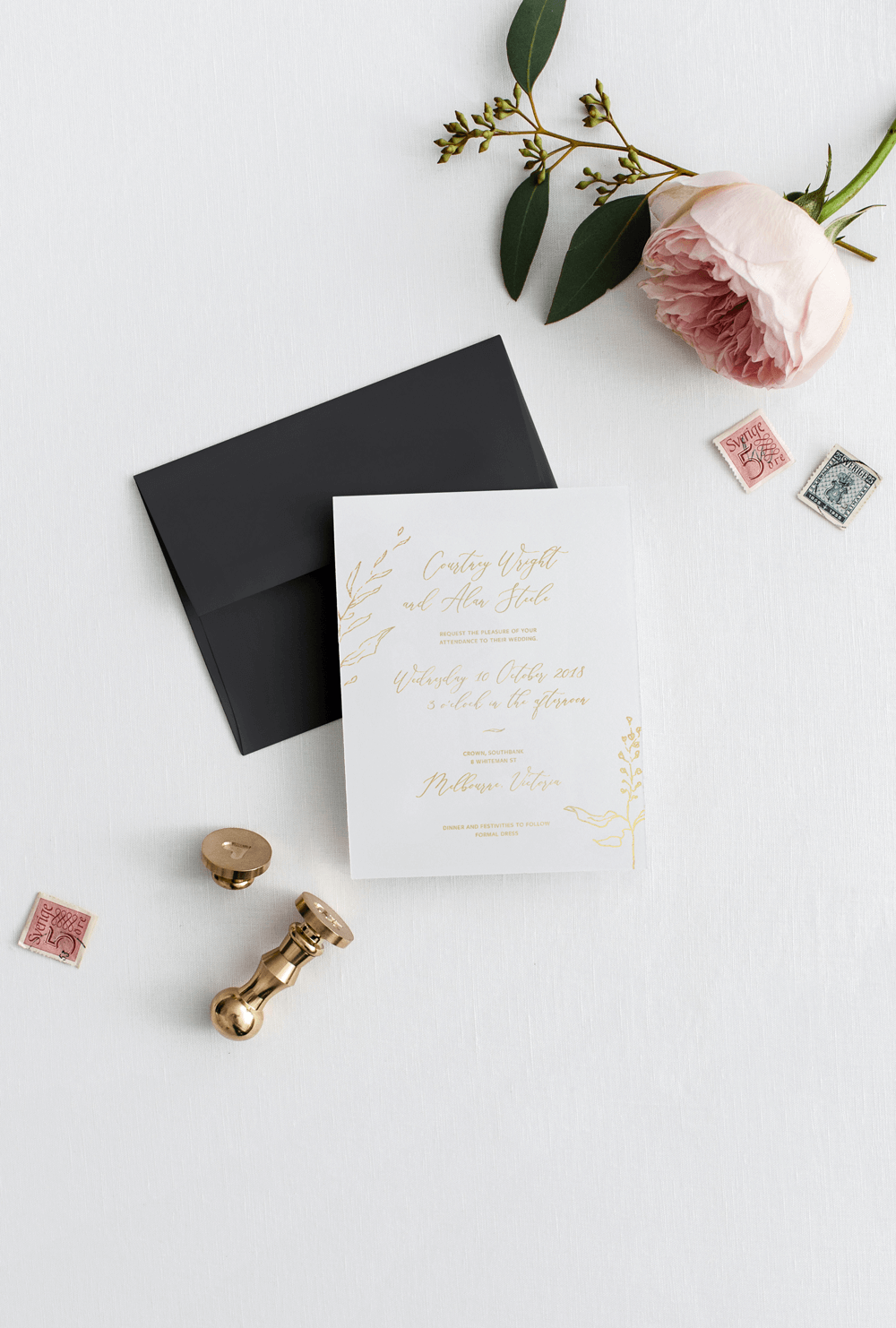 invitation with gold foiled printed letters, white card stock with black envelope and white card
