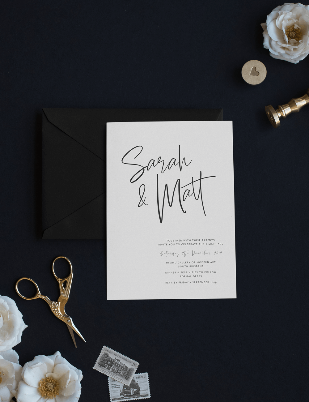 wedding invitation white card with signature letters