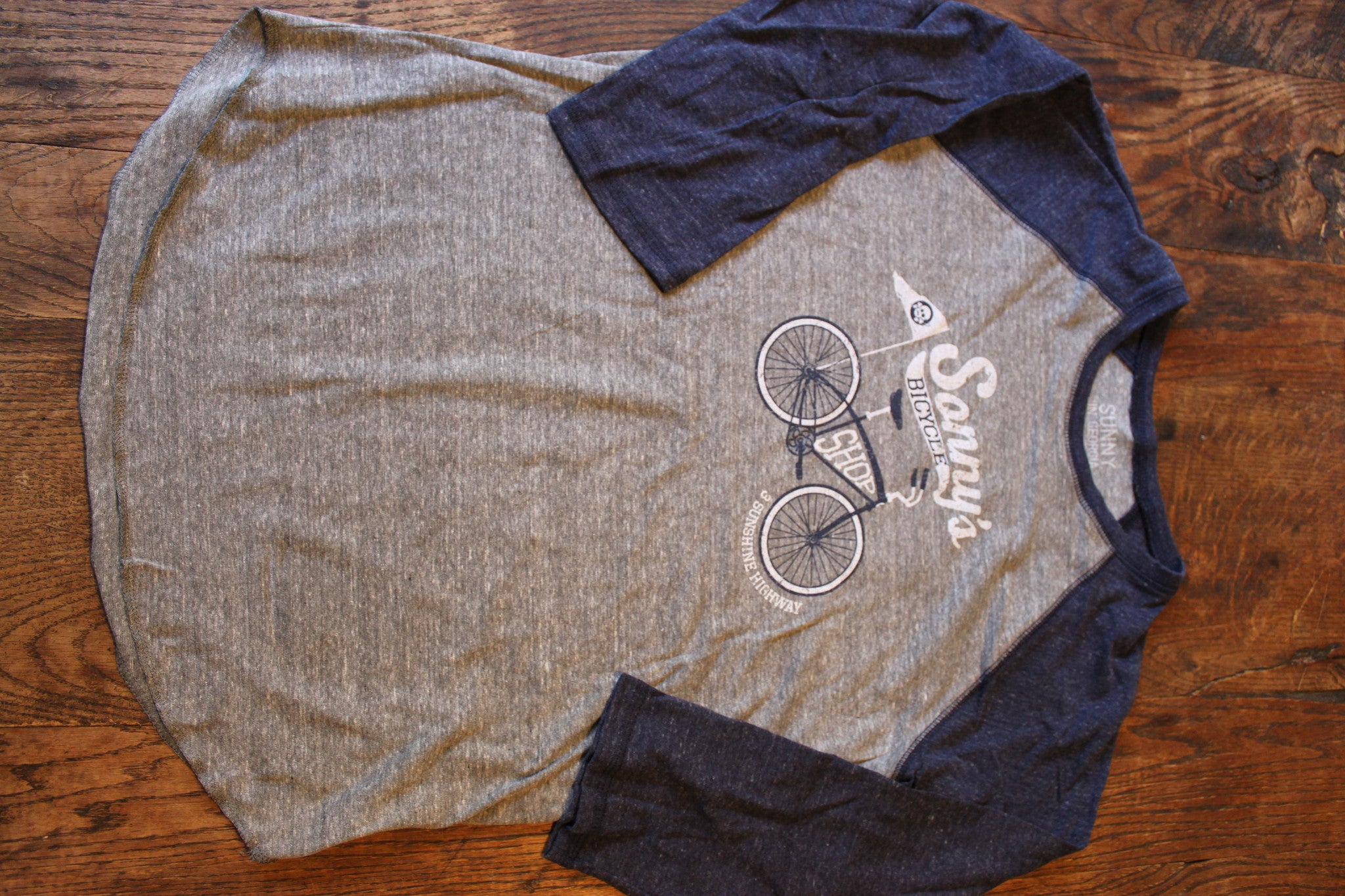 """sonny's bicycle shop"" MADE IN USA unisex adult raglan"