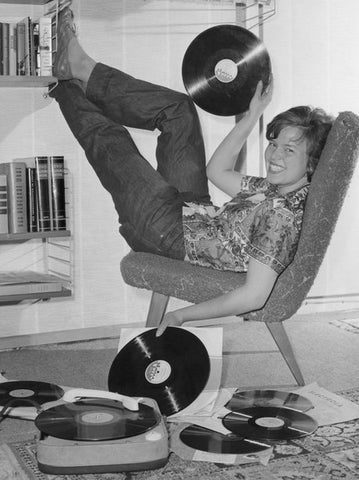 1950s teenager listening to records