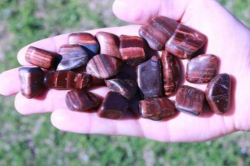 Red Tigers Eye Tumbled Stone-Cosmic Cuts