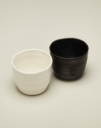 Artisan ceramic black and white bare tumbler cups in snowflake and mussel glaze