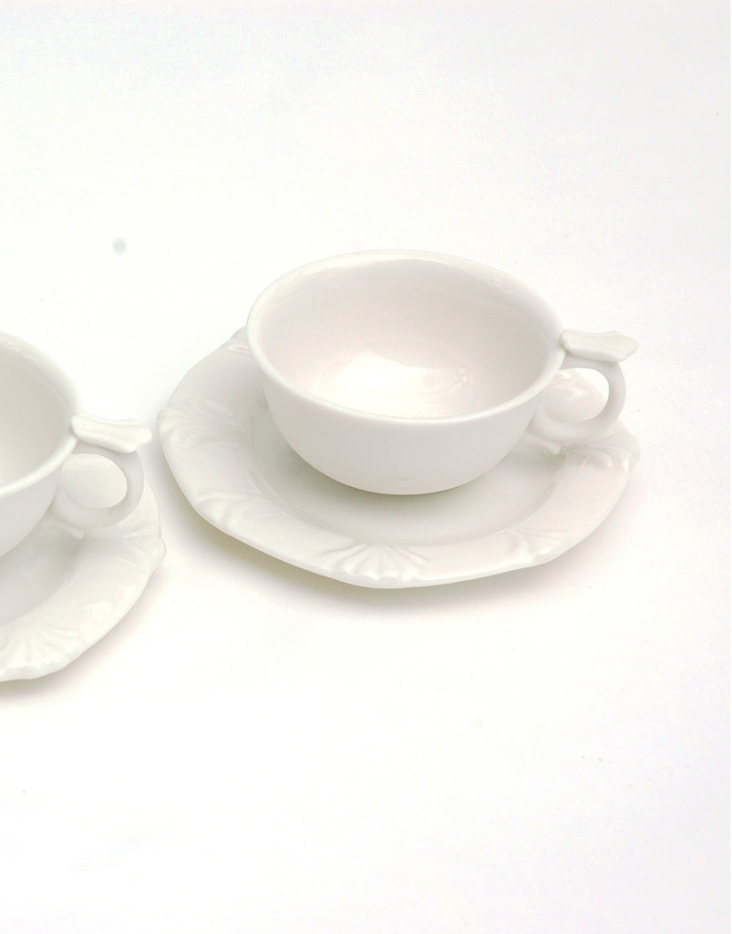 handmade ceramic white teacup and saucer