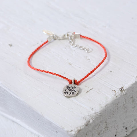 Coral Silk and Thai Charm Bracelet