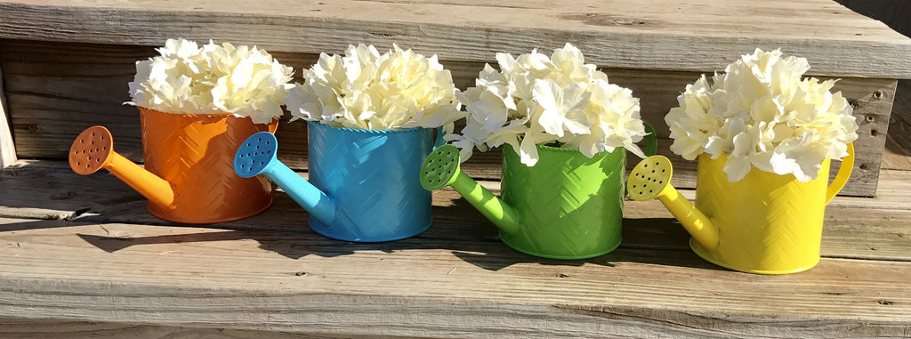 Colored flowerpot watering cans - Knot and Nest Designs