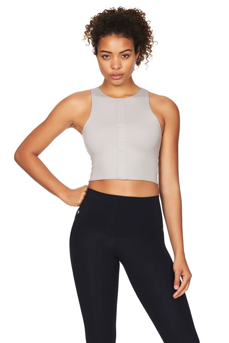 Model wearing grey crop top and black tights front view