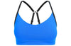 Blue sports bra with black strap details front view