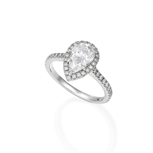 Pear shape diamond engagement ring with halo
