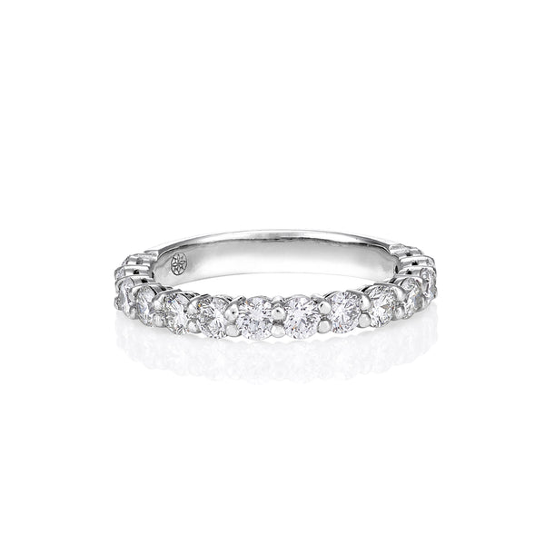 Shared claw diamond eternity band