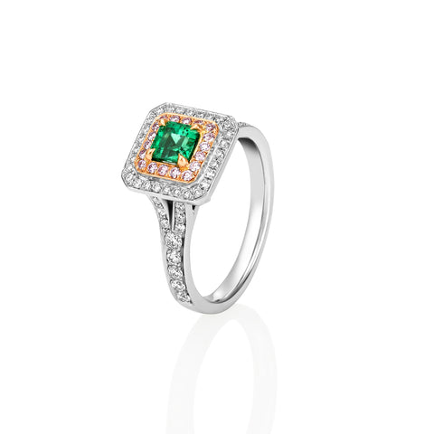 Emerald and Pink diamond ring in Platinum