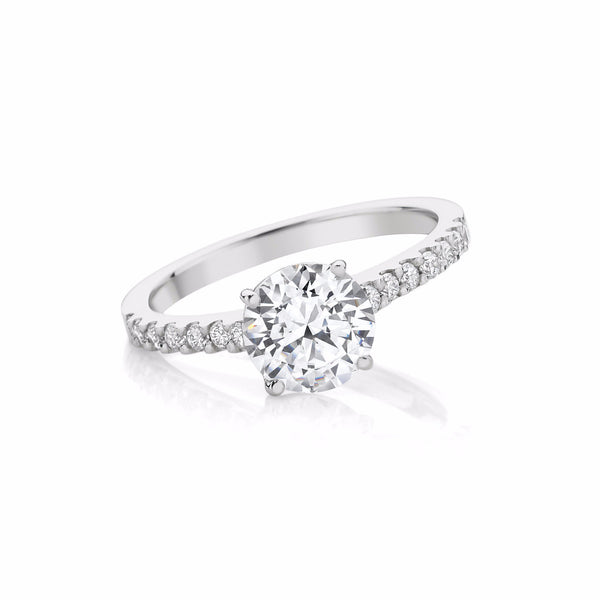 Four Claw Diamond Engagement Ring with Nova set Diamonds
