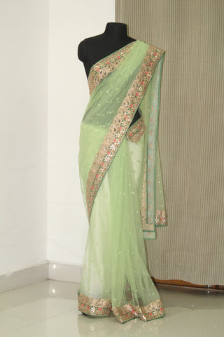 Green net butti saree