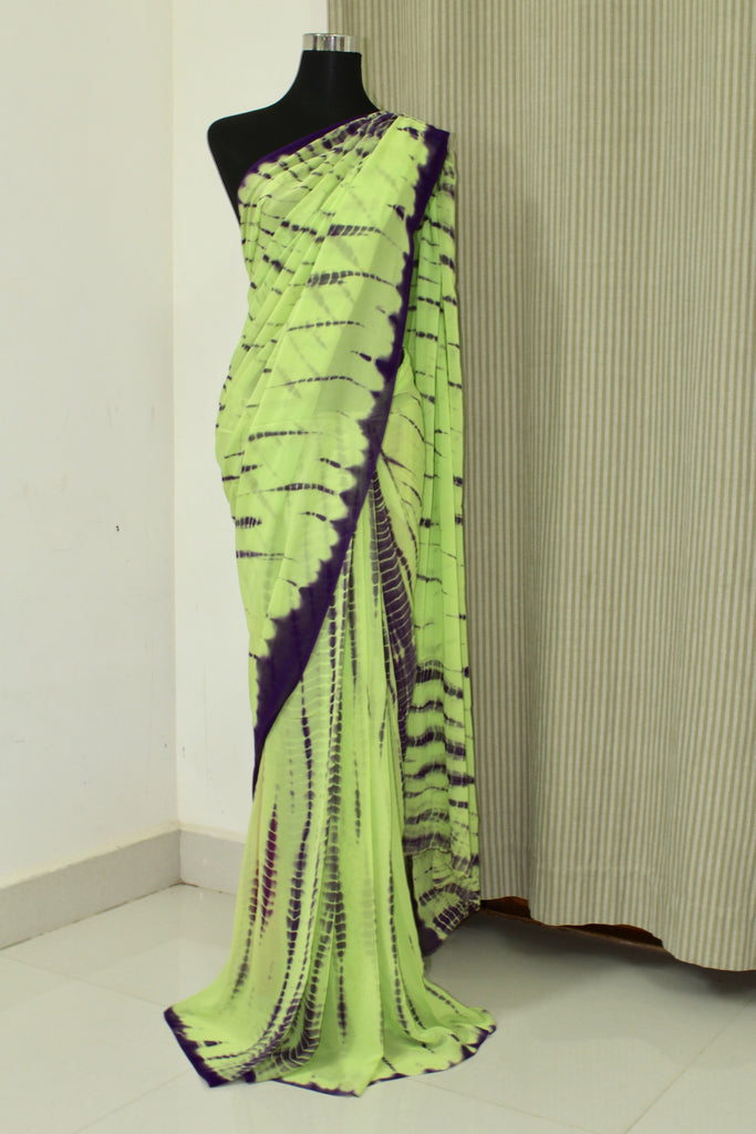 how to tie a saree Saris, traditional indian garments worn primarily by hindu women, consist of several yards of light material that are draped around the body.