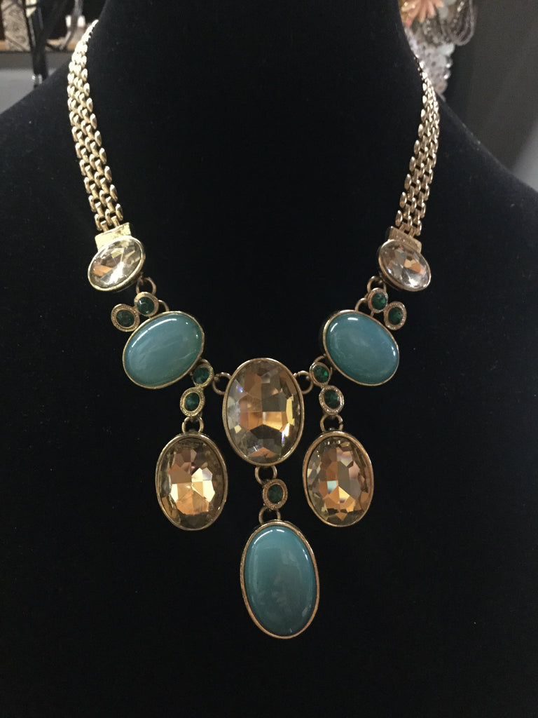 Gold chain necklace with oval stone drops