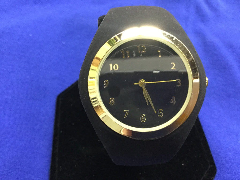 Watch gold trimmed face with black rubber band