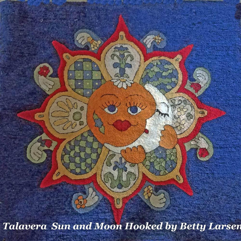 Traditional Talavera Sun with brilliant rays and a crescent moon over the face