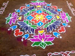 Square rangoli on pavement