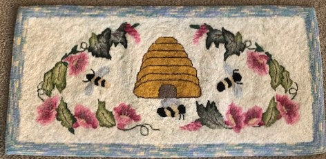 Finished rug with morning glories surrounding the skep with bees