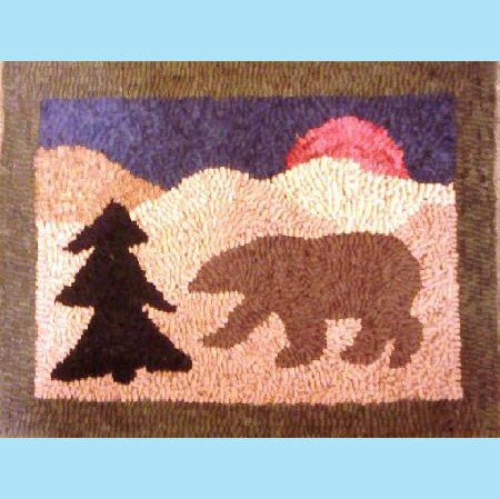 This is a small simple pattern which can be hooked as a quick project or beginner piece. It shows a silhouetted bear and pine tree with the hills behind.