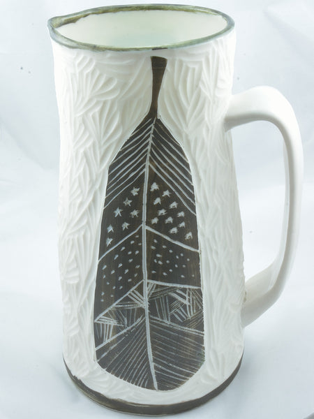 CARVED PORCELAIN PITCHER