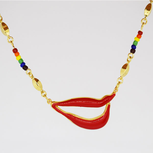 Sylvia Bennett signature lips pendant with PermaGold Chain and multi-colored beads