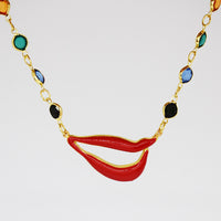 Sylvia Bennett signature lips pendant with PermaGold Chain and multi-colored crystals