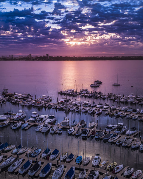 SUNRISE RAYS IN MATILDA BAY
