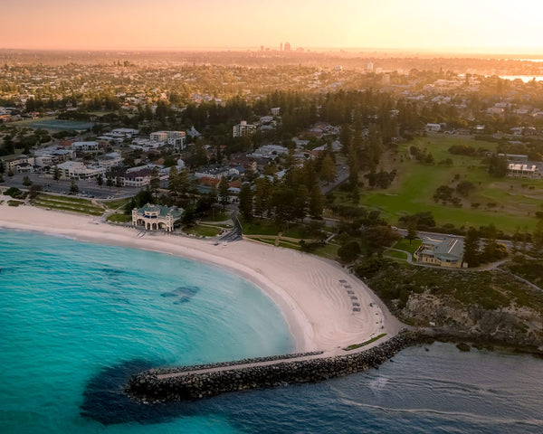 First sun lights over Cottesloe Beach