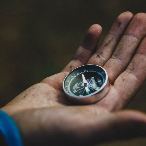 Image of man holding a compass.