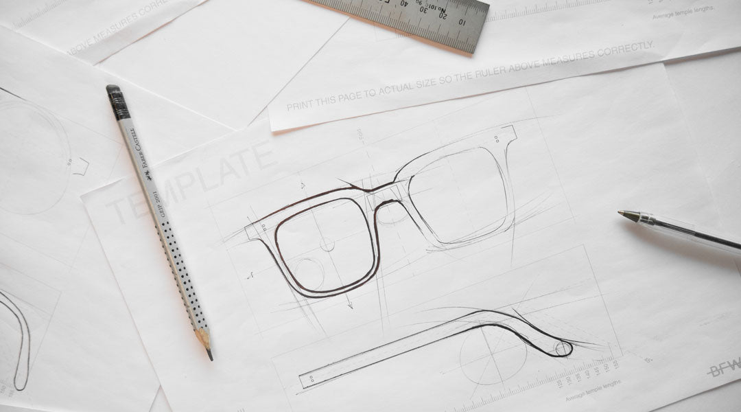 A sketch of a sunglasses frame on white paper