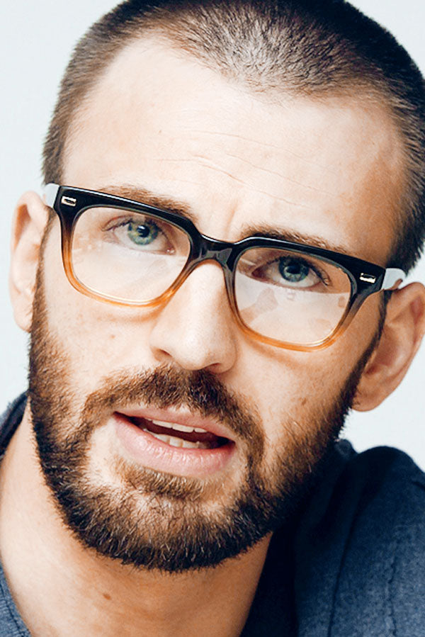 Actor Chris Evans wearing thick square gradient spectacle frame