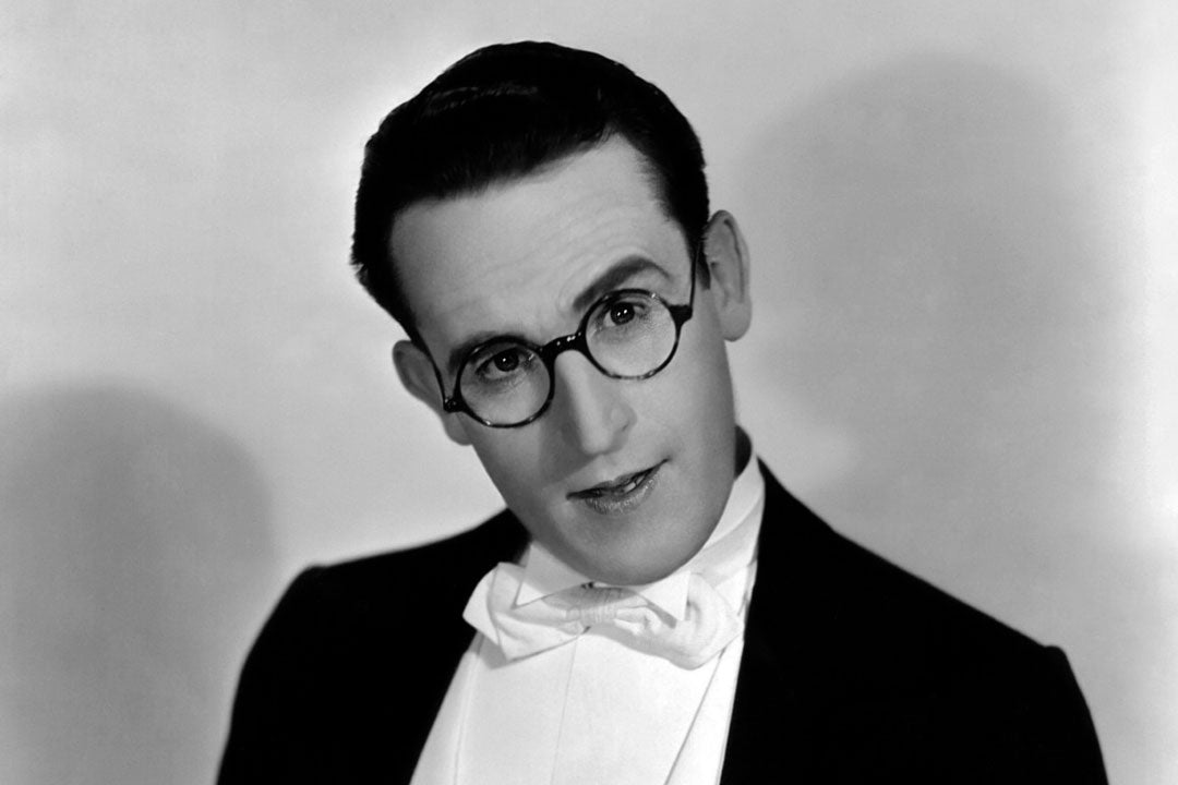 Actor Harold Lloyd wearing round totoiseshell glasses and suit
