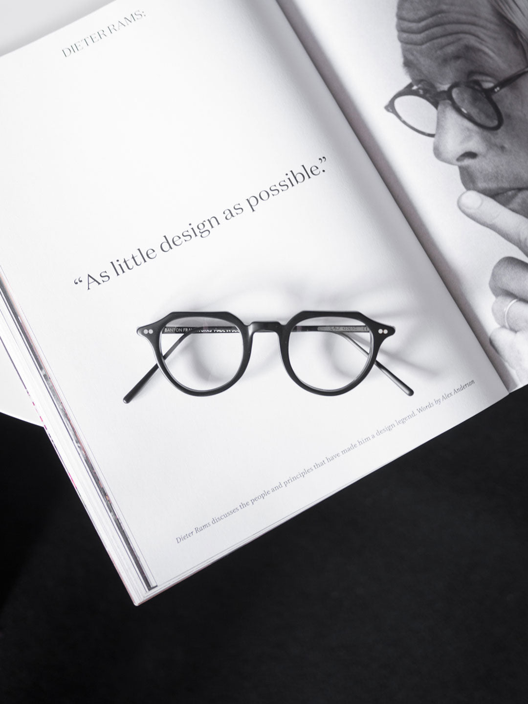 Aerial view of Dieter Rams glasses tribute spectacle frame upon white table and magazines