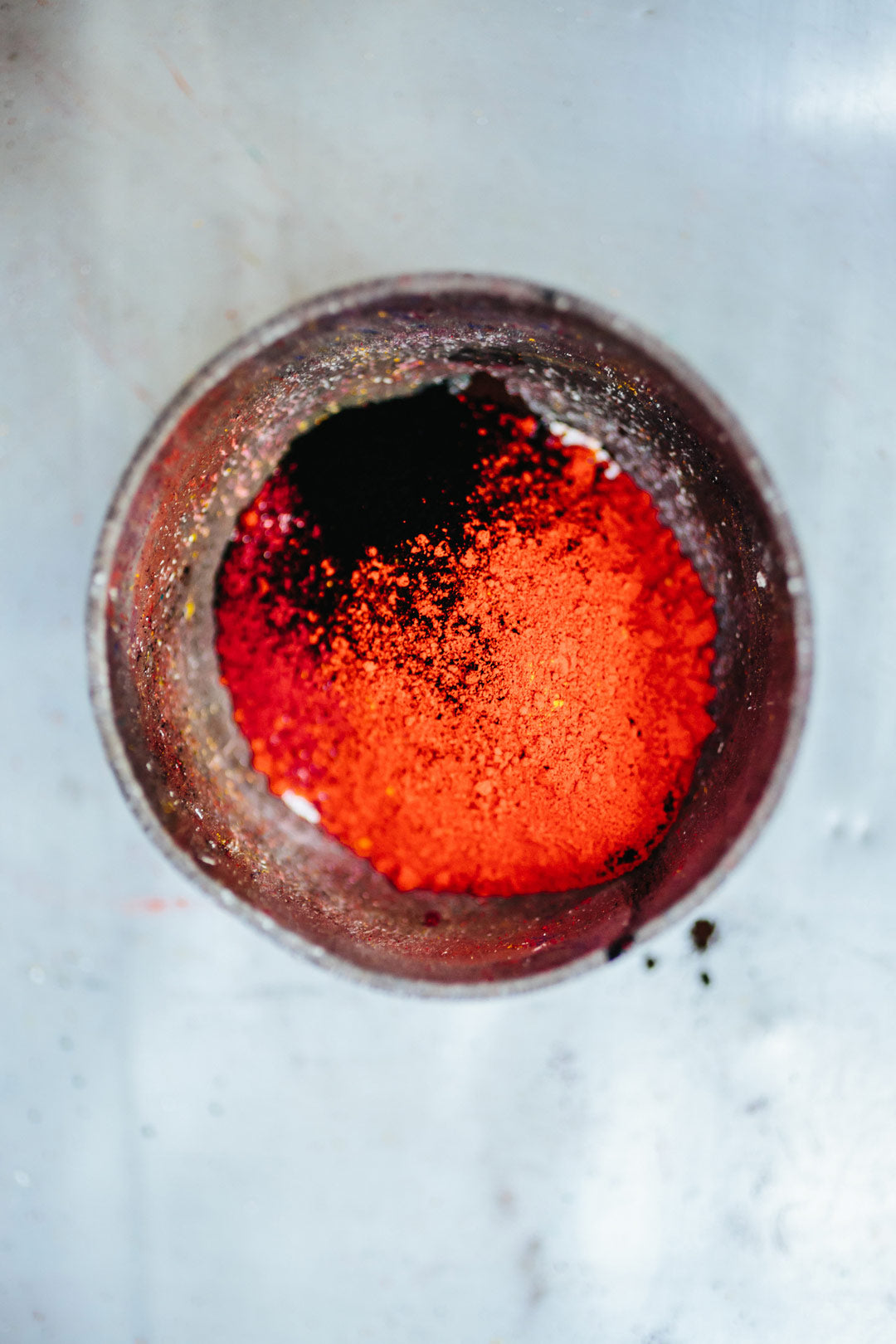 Aerial view of red powdered dye for colouring acetate